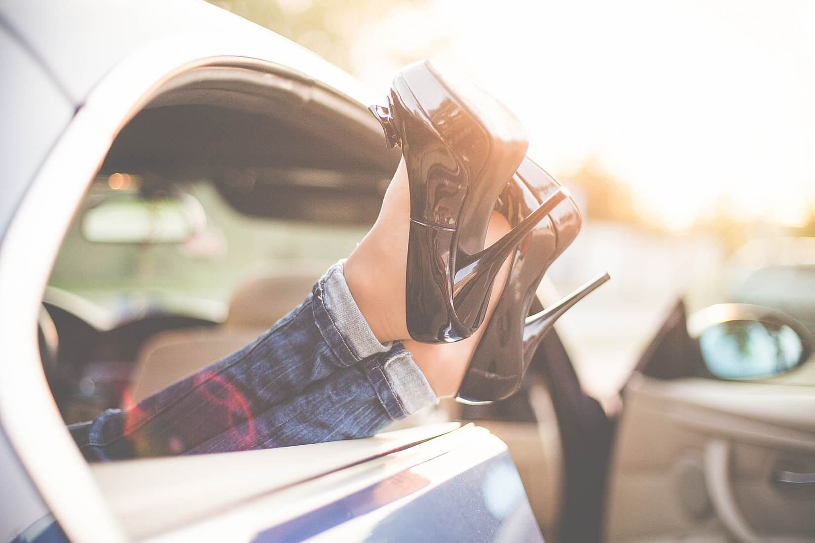 sexy-woman-legs-on-high-heels-out-of-car-windows