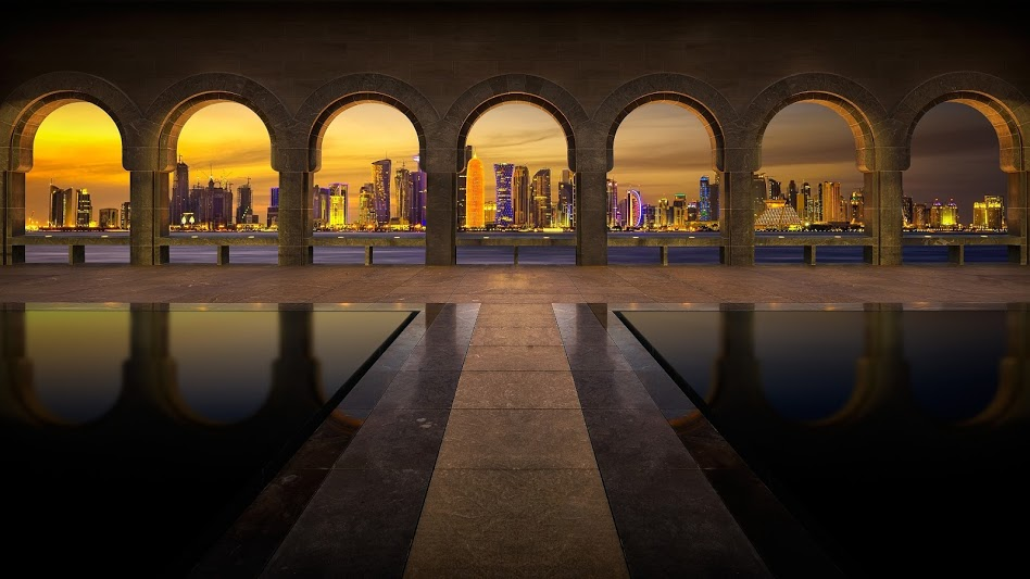 arches-with-view-of-the-city-skyline