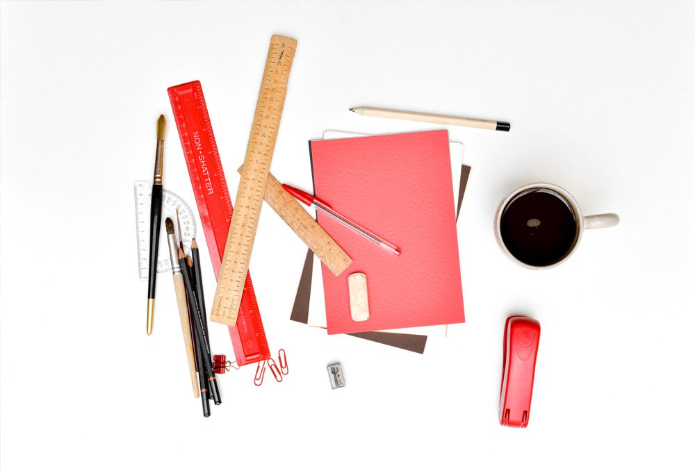 Stationary-Objects-On-White-Desk