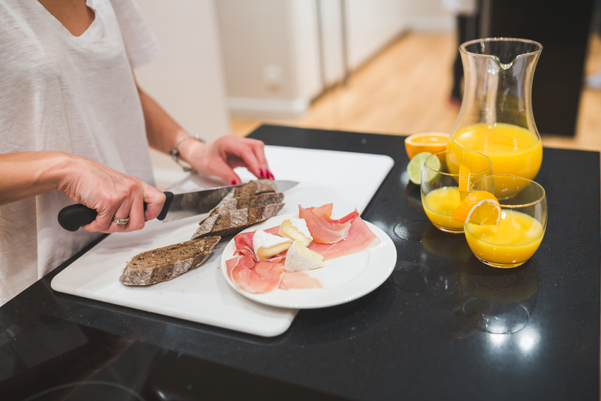woman-preparing-lunch-on-the-kitchen-table2