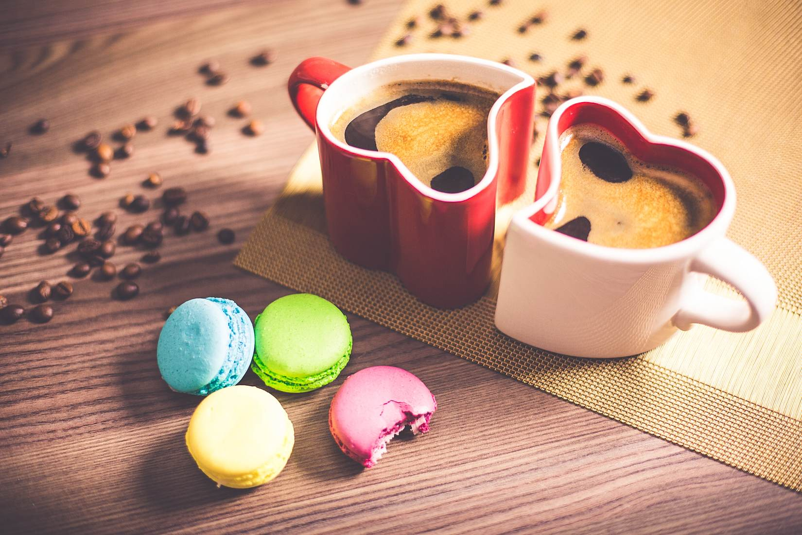 coffee-in-heart-cups-and-sweet-yummy-macarons