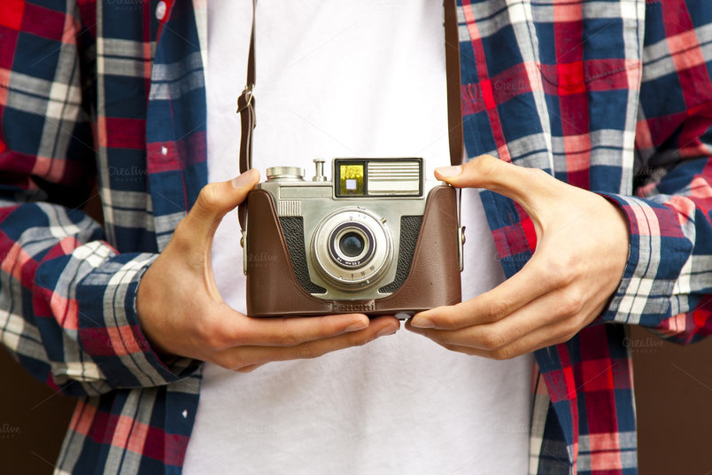 hands-with-vintage-photo-camera-2