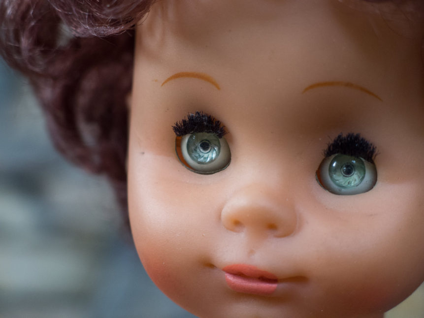 doll face with blue eyes