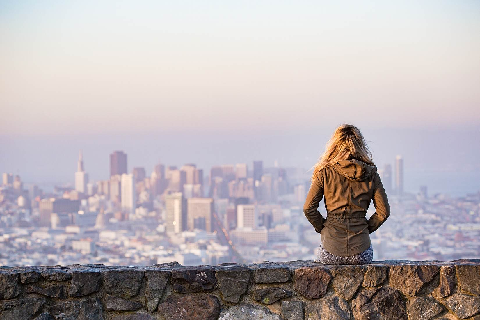 young-girl-enjoying-moment-and-looking-over-the-city-of-san-francisco