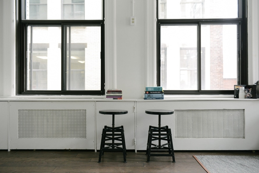 black-stool-in-front-of-two-black-framed-glass-window