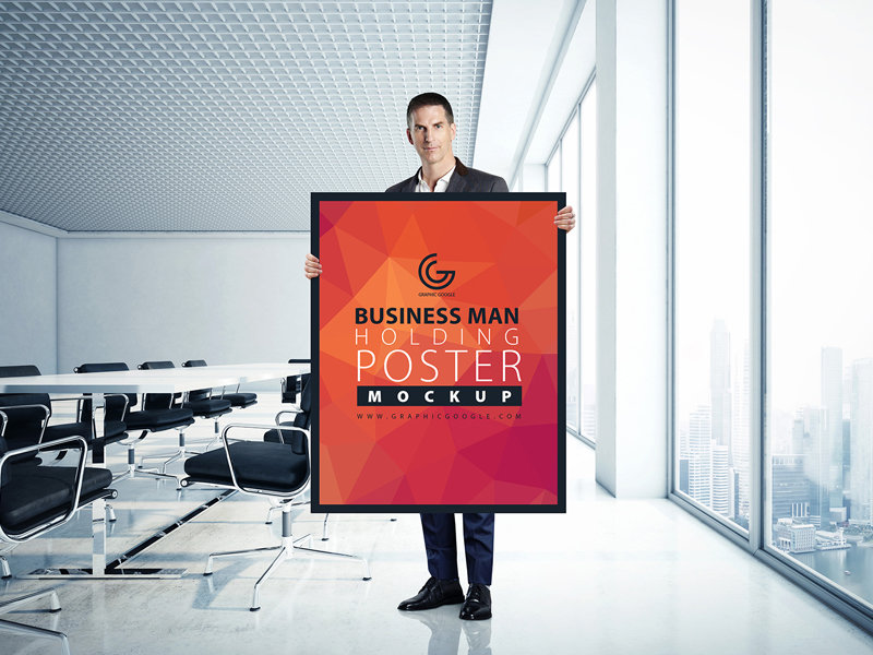 business-man-holding-poster-mockup-2