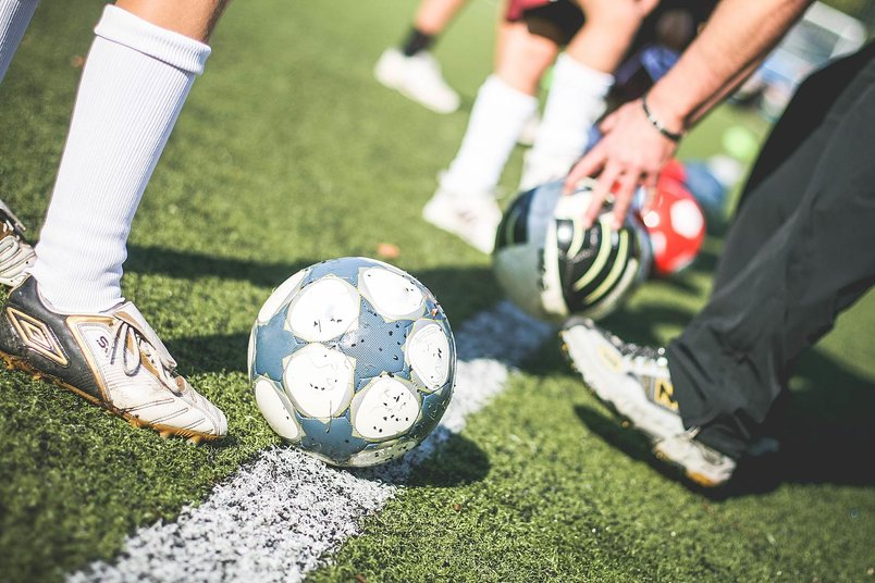 football-field-training-players-with-soccer-ball-2
