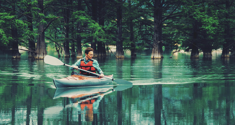 man-paddling-in-kayak-on-lake-2