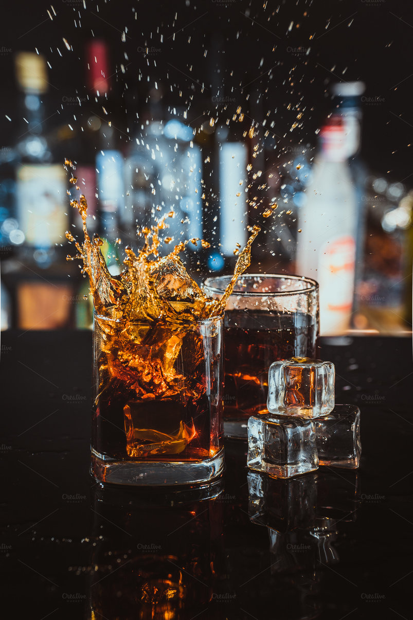 two-glasses-of-whiskey-on-a-blurred-background-bar-2