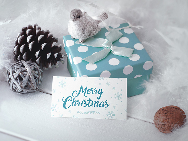 business-card-in-christmas-scenery-free-psd-mockup